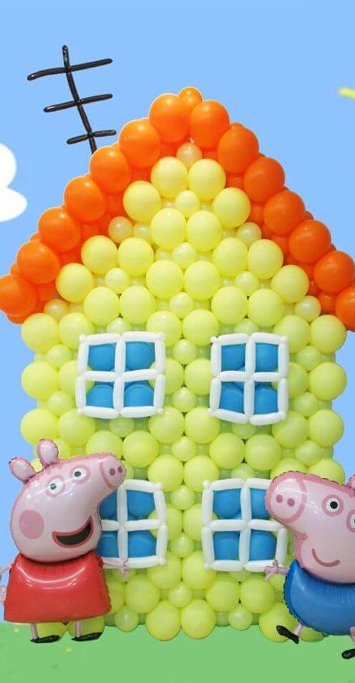 Escultura casa peppa pig y george