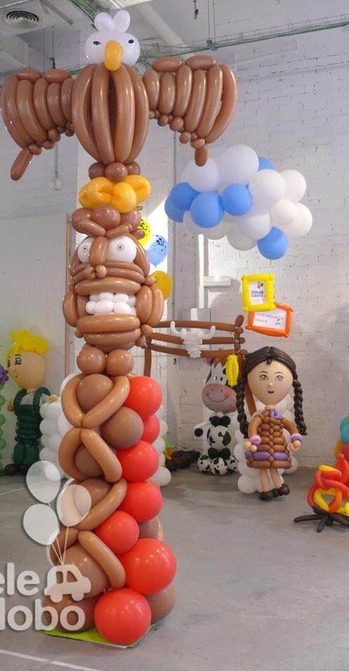 Columna de globos totem indios y vaqueros